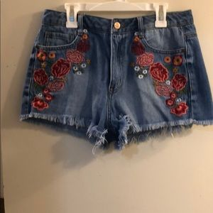 Blue jean shorts with flower detail